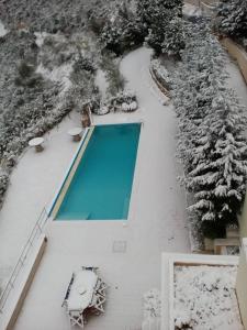 Вид на бассейн в Skroponeria View Apartments или окрестностях