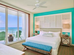 A bed or beds in a room at Margaritaville Hollywood Beach Resort