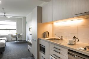 A kitchen or kitchenette at Quest Napier Serviced Apartments
