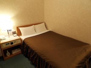 Cama o camas de una habitación en Southern Cross Inn Matsumoto