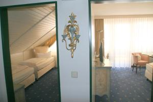 A bed or beds in a room at Best Western Hotel Rhön Garden