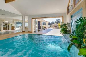 The swimming pool at or near One Mile Mansion - Private Coastal Retreat