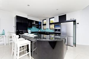A kitchen or kitchenette at The Ultimate Ocean View - A Luxury Home
