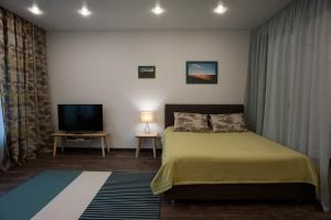 A bed or beds in a room at Romantic place apartment in Baikal Hill Listvyanka