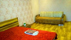 A bed or beds in a room at Apartment in Volgogradskaya