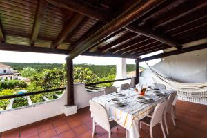 A restaurant or other place to eat at WHome | Ericeira Private Villa