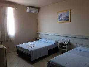A bed or beds in a room at Hotel Central