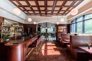 The lounge or bar area at The Dewberry Charleston