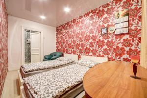 Кровать или кровати в номере Апартаменты у Площади Ленина