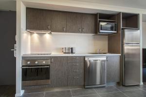 A kitchen or kitchenette at Quest Rockhampton