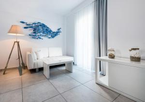 Ein Bett oder Betten in einem Zimmer der Unterkunft Gaia in Style - Adults Only