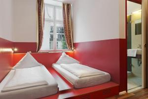 A bed or beds in a room at Ballhaus Berlin Hostel