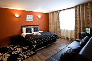 A bed or beds in a room at Desalis Hotel London Stansted