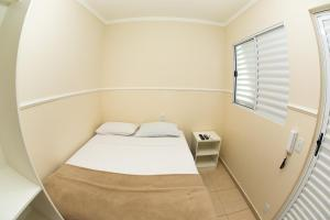 A bed or beds in a room at Residencial Villa Container