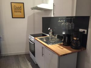 Cuisine ou kitchenette dans l'établissement La Terrasse des Forges