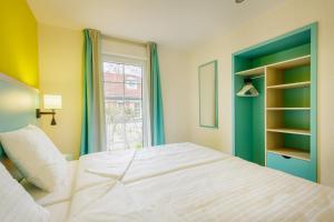 Ein Bett oder Betten in einem Zimmer der Unterkunft Center Parcs Nordseeküste Bremerhaven