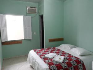 A bed or beds in a room at Pousada Gaivota