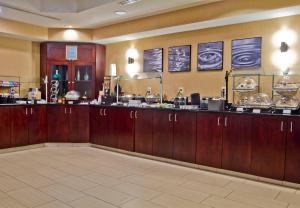 A restaurant or other place to eat at SpringHill Suites by Marriott Charlotte Airport