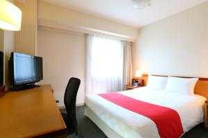 A bed or beds in a room at HOTEL GLOBAL VIEW Niigata