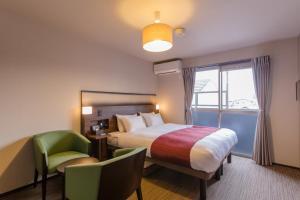 JAPANING HOTEL 御前にあるベッド