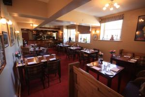 A restaurant or other place to eat at Worsley Arms Hotel