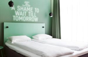 Säng eller sängar i ett rum på Comfort Hotel Karl Johan