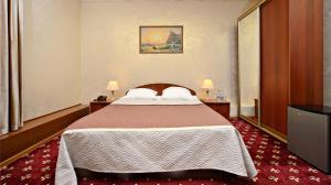 Кровать или кровати в номере Гостиница Русь