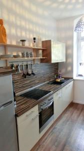 A kitchen or kitchenette at Apartment KiezFlair