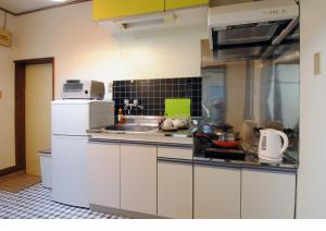 A kitchen or kitchenette at Hostel Hana An