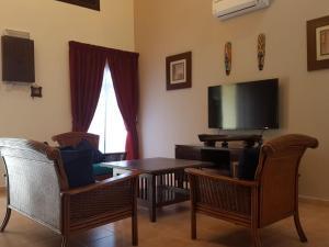 A seating area at Green Villa Famosa Alor Gajah