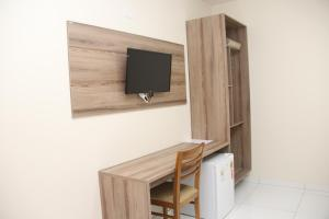 A television and/or entertainment center at Hotel Executive