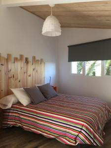 A bed or beds in a room at Hostel Cañaveral