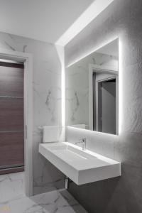 A bathroom at Elysium Boutique Apartments