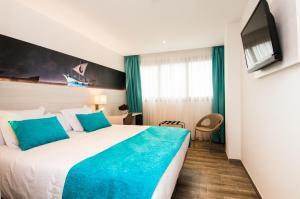 Cama o camas de una habitación en Hotel Censal