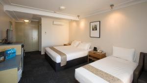A bed or beds in a room at Aurora Alice Springs