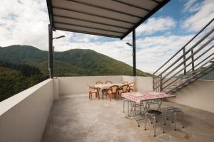 A balcony or terrace at Habitat Heart B&B