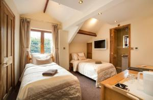 A bed or beds in a room at Acorns Guest House