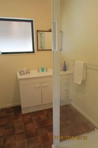 A bathroom at Wilderness Cottage