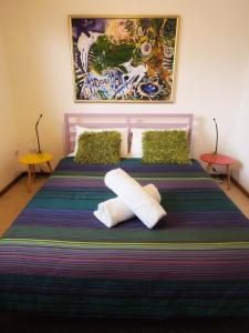 A bed or beds in a room at Pacific Vista Budget Retreat