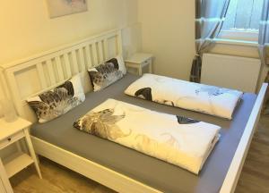מיטה או מיטות בחדר ב-Gästehaus Dolce Vita