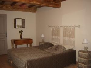 Un ou plusieurs lits dans un hébergement de l'établissement A La Mare du Vieux Chêne