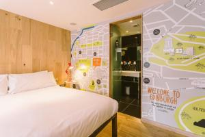 A bed or beds in a room at Grassmarket Hotel