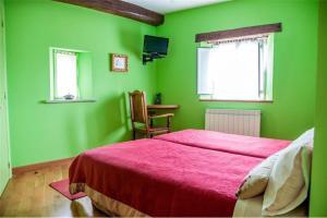 A bed or beds in a room at Posada Rural La Sosiega