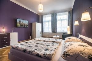 A bed or beds in a room at Charles IV Apartments