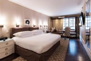 A bed or beds in a room at City Club Hotel