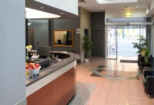 A kitchen or kitchenette at Adelaide Riviera Hotel