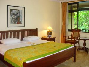 A bed or beds in a room at Hotel Puri Bambu