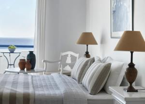 A bed or beds in a room at San Marco Hotel and Villas