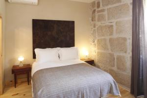 A bed or beds in a room at Casa Estrela