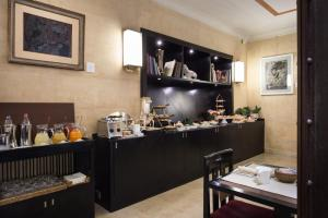 A restaurant or other place to eat at Art Hotel Novecento